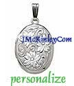 Small sterling silver oval locket embossed with flowers