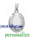 Small sterling silver oval locket with flowers and scroll