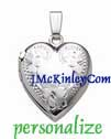 Small sterling silver heart locket with flowers