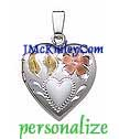 Small sterling silver heart locket with flowers and green le