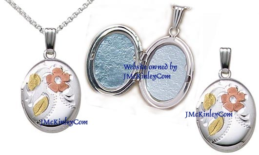 Small sterling silver oval locket with flower and leaves