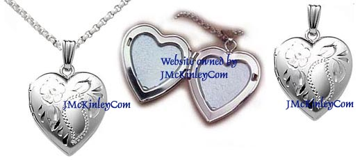 Small sterling silver heart locket with flower and leaves