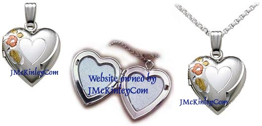 Small sterling silver heart locket with flower and heart