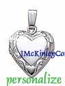 Small sterling silver heart locket embossed