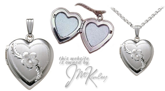 Sterling silver heart locket with a flower and scroll