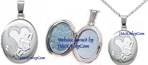 Small sterling silver oval locket with heart and flower